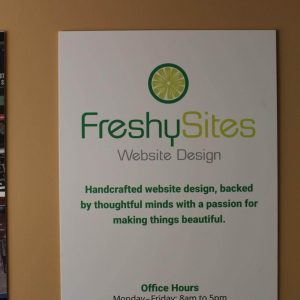 FreshySites Fairfax sign with hours
