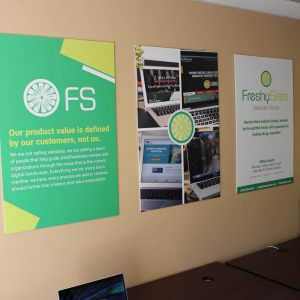 FreshySites Fairfax office space with laptop and posters
