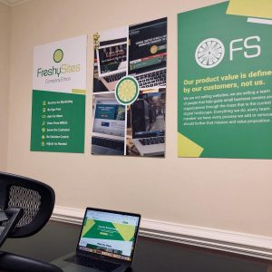 FreshySites desk and posters in Raleigh, NC office